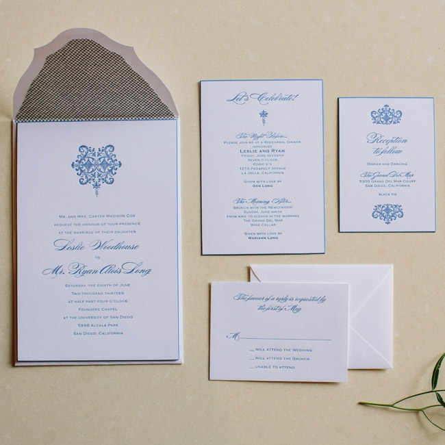 "The custom-made invitations were printed on heavy card stock with a cornflower blue border, navy type and a decorative design motif that was echoed on the ceremony programs, the menus, table numbers and place cards. ""My favorite part of the invitations where the gorgeous envelops because the envelope flap was ornate instead of a straight edge,"" say ..."