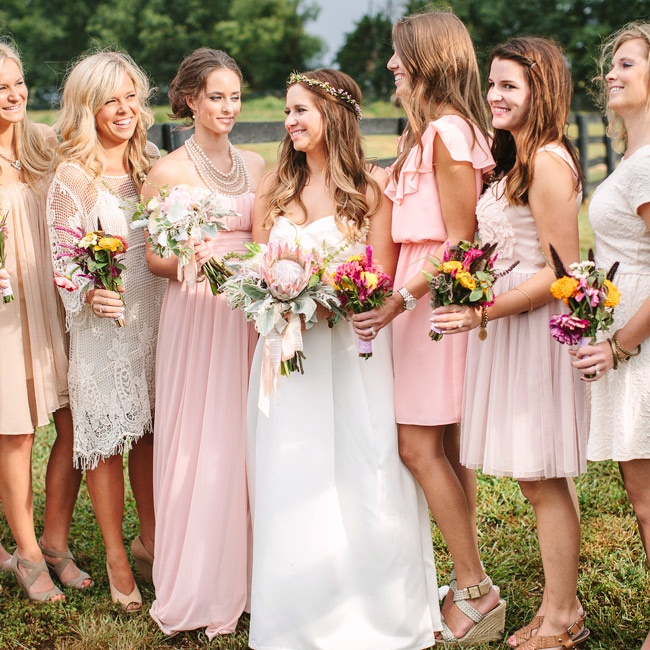 Bridesmaids wore an array of styles and colors down the aisle ranging from ivory, to tan and blush.