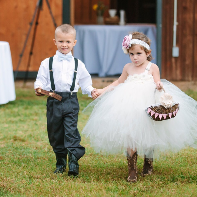 The couple's ring bearer donned suspenders and a light blue bowtie while the flower girl wore a white tulle dress with cowboy boots.