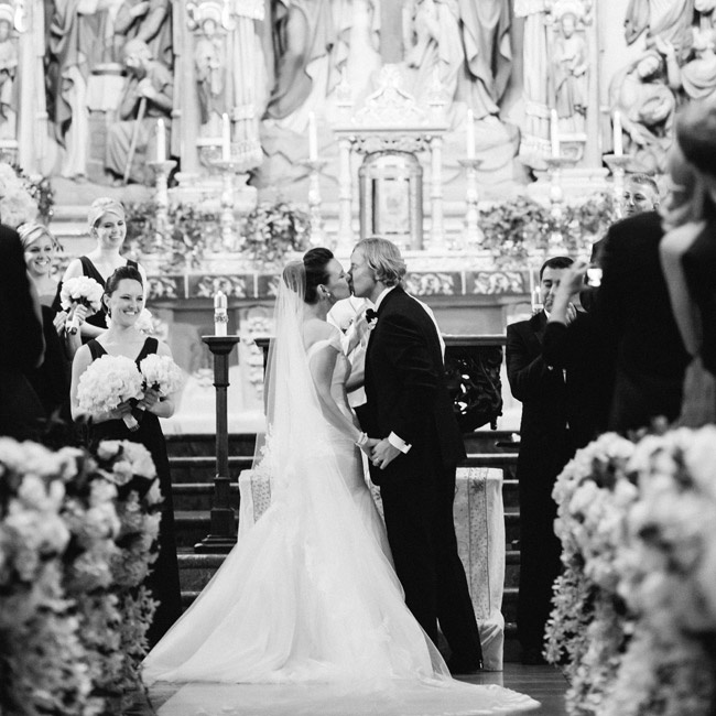 Leslie decided to wear her hair in a gorgeous chignon not only because of it's formal vibe but also because it could support the weight of her Cathedral length veil.