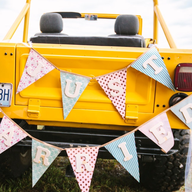 """The couple hopped in a topless, yellow Jeep after the ceremony. It was decorated with a """"Just Married"""" sign in different patterns and colors."""