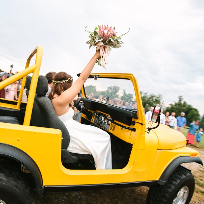 The newlyweds jumped in a yellow Jeep with the top off to take photos before the reception began.