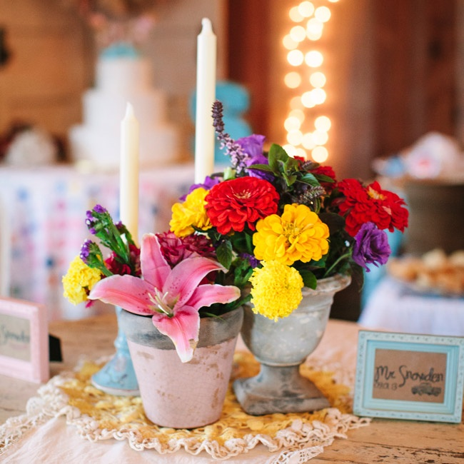 Colorful vases of lilies and carnations topped each table at the reception.