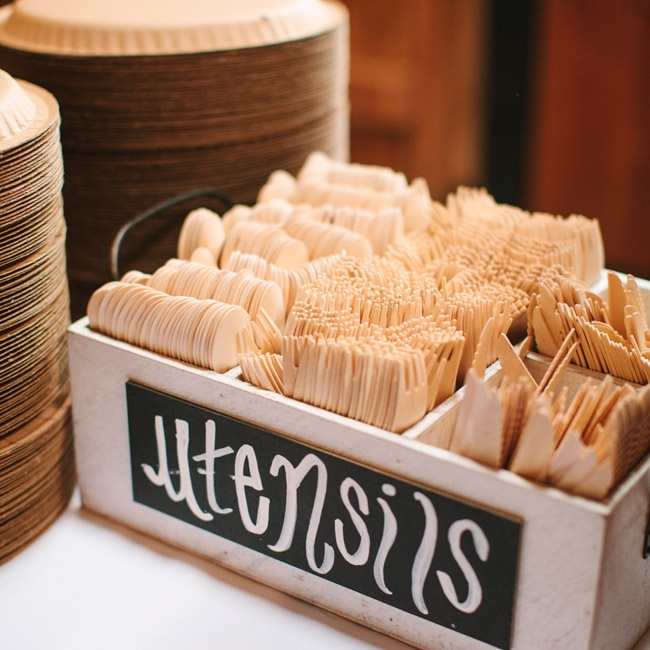Wooden utensils set up buffet-style added to the rustic charm of the barn reception.