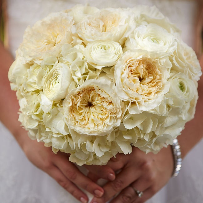 Carly carried an ivory bouquet filled with peonies, hydrangeas and ranunculuses.