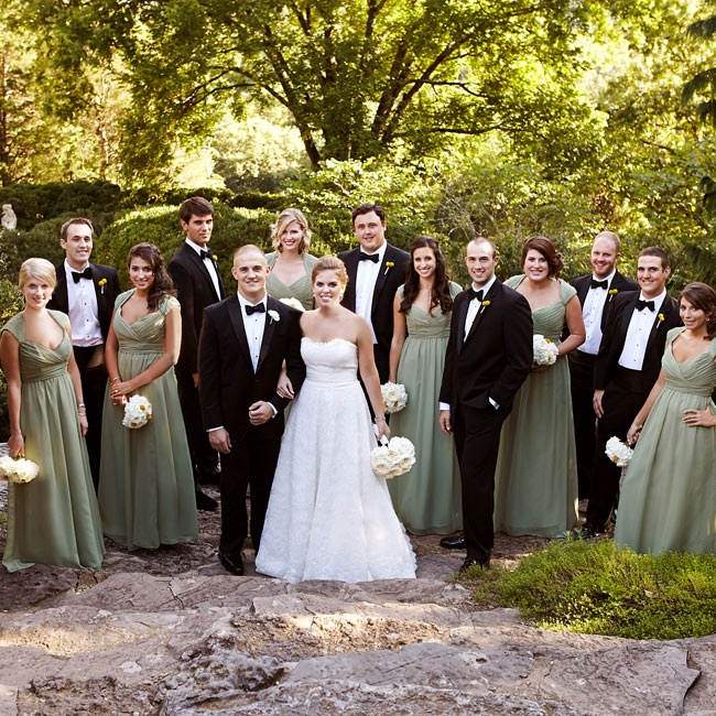 The bridal party was decked out in classic formal attire; the girls wore long sage green gowns with cap sleeves, while the guys wore sleek black tuxedos with black bow ties.