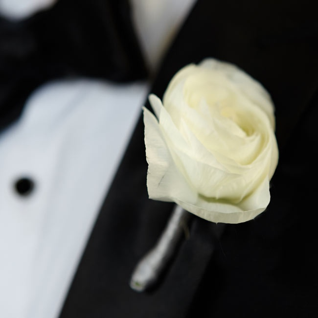 Joe wore a single white rose on his lapel wrapped with silver ribbon.