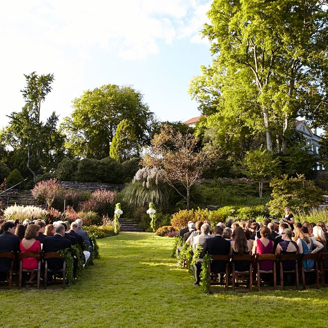 The ceremony was held outdoors in the lush sunlit gardens at Cheekwood.