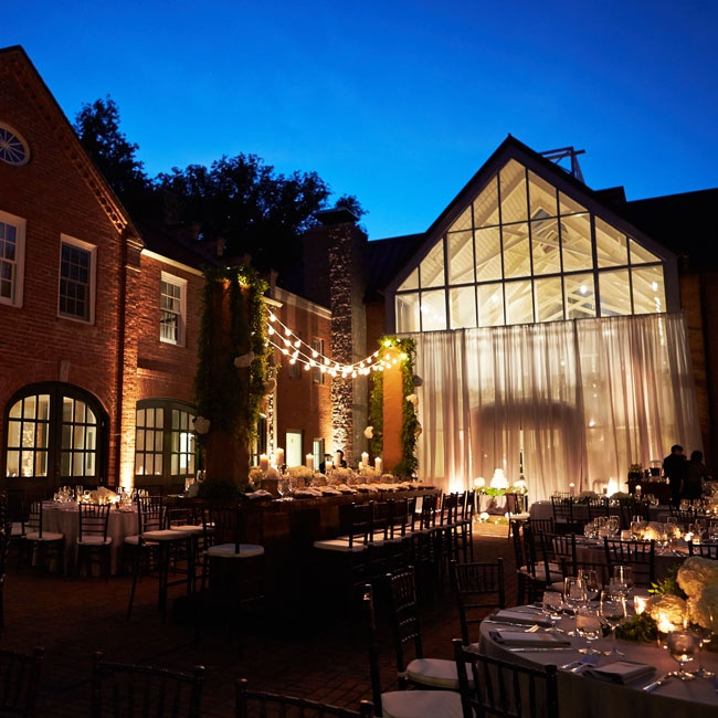Bistro lights, candles and uplighting brought a warm, romantic glow to the Frist Courtyard at Cheekwood Botanical Garden where the couple's reception was held.