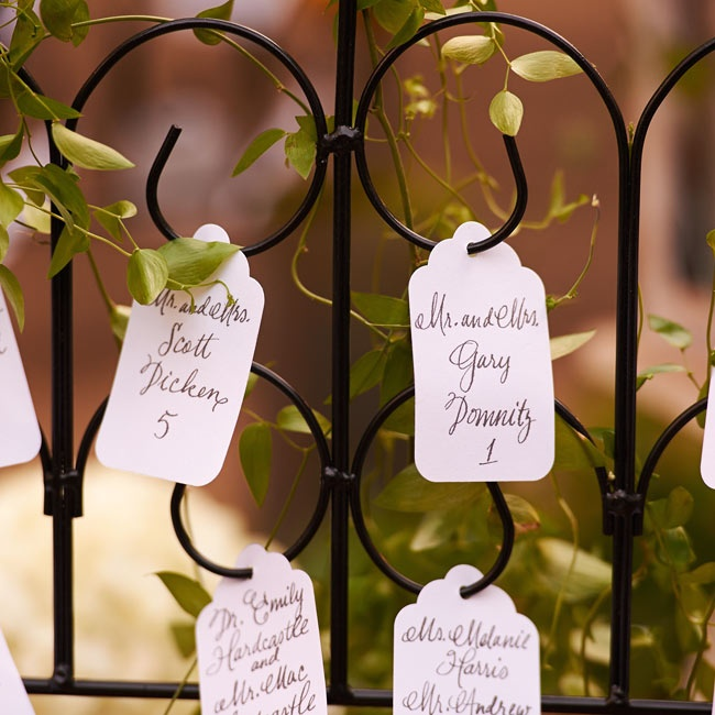 Simple, white gift tags were hand calligraphed with each guests name and their seating assignment.