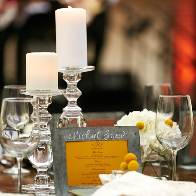 Dark yellow menus with distressed metal frames were placed at each guests seat and doubled as a place card.