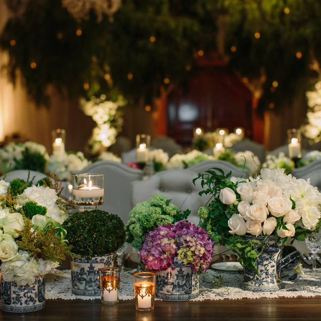The glamorous indoor garden reception featured over 60 Chinoiserie vases of various sizes filled with an array of beautiful white flowers.