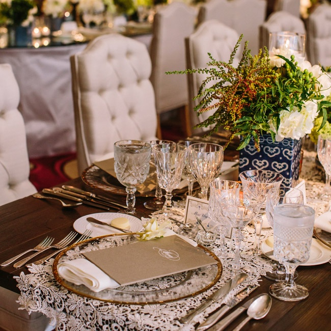 The stunning place settings took on an antique classical feel with etched glasses, vintage-inspired silverware and gold-rimmed chargers set on a lace runner.
