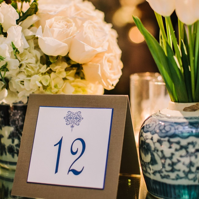The navy and cream design motif inspired by Chinoiserie vases was also utilized for the table numbers.