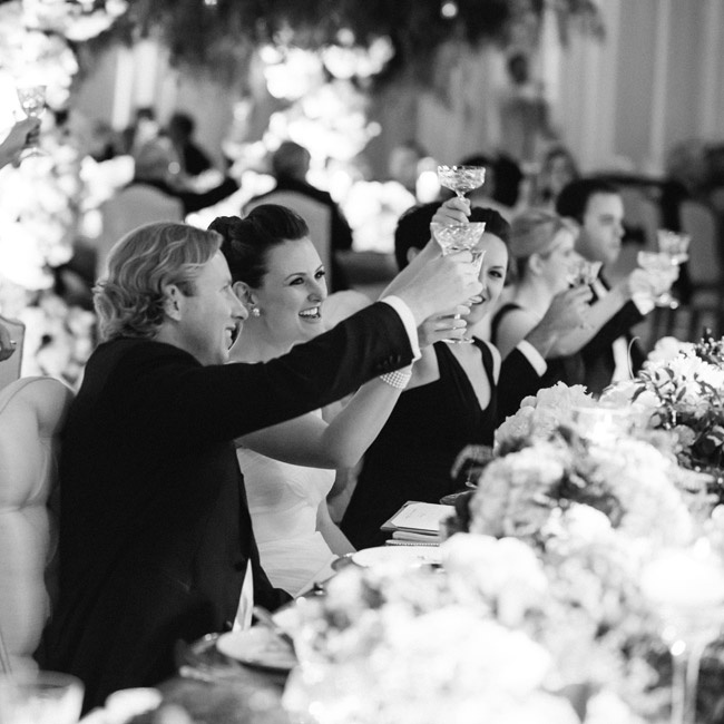 Guests all raised etched antique glasses to toast the newlyweds during the joyous celebration.