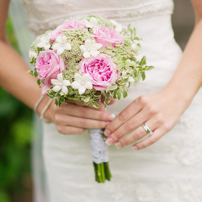 Roses, Queen Anne's lace and stephanotis flowers filled the bride's bouquet as she walked down the aisle.