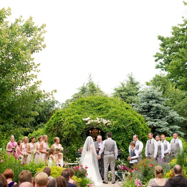The couple exchanged vows in a garden setting on their wedding day.