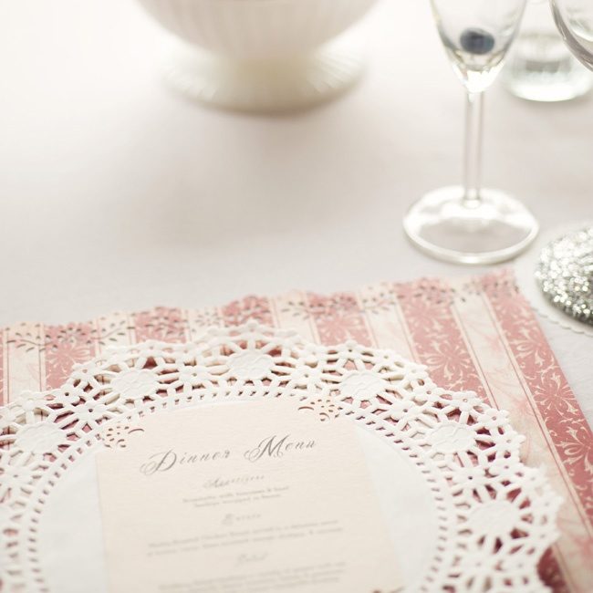 Menu cards were printed with laser-cut doily-inspired edges at the reception.