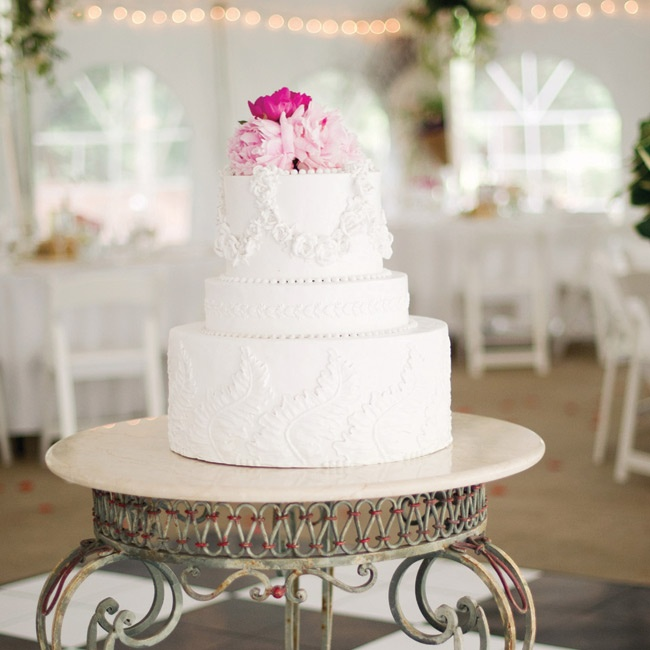 Since the couple actually doesn't like cake, a large faux cake took center stage at the reception. Guests were served with a variety of sheet cakes.