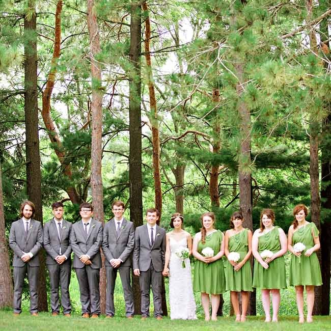 The bridesmaids wore one-shoulder chiffon dresses in a playful green color, while the guys sported wore classic gray suits.
