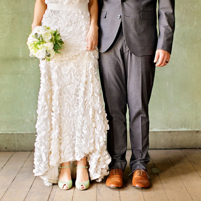 Lauren walked down the aisle in a pair of pale mint green peep-toe heels with ankle straps that felt playful and feminine.