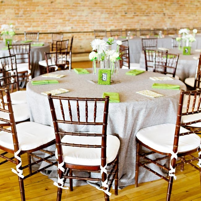 The tables were covered with textured gray linens with pistachio and patterned napkins.