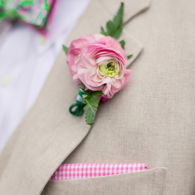 Tans suits were accented with pink ranunculus flower boutonnieres.