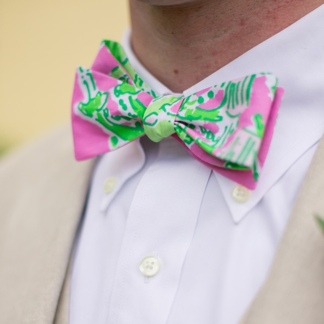 The couple accented their light tan suits with pink and green bowties.