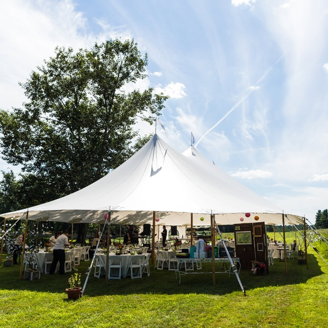 The reception took place beneath a pitched white tent on a great lawn.