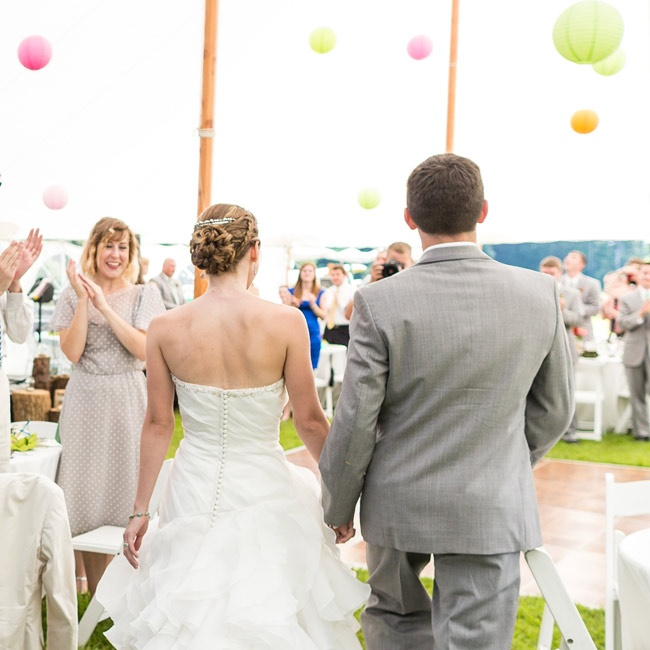 Inside the reception tent, paper lanterns in green, pink and orange made for a whimsical atmosphere.