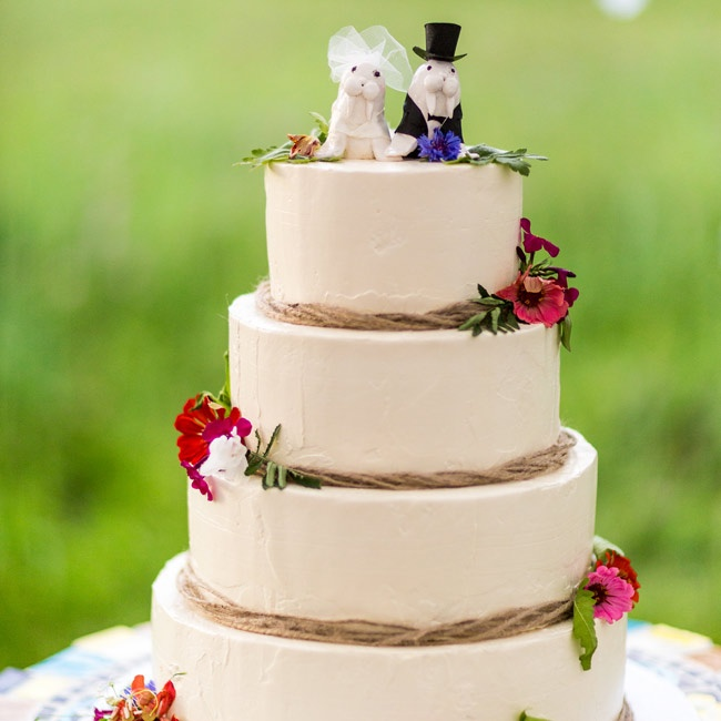 The couple topped their four-tiered, neutral cake with an adorable walrus bride and groom cake topper.