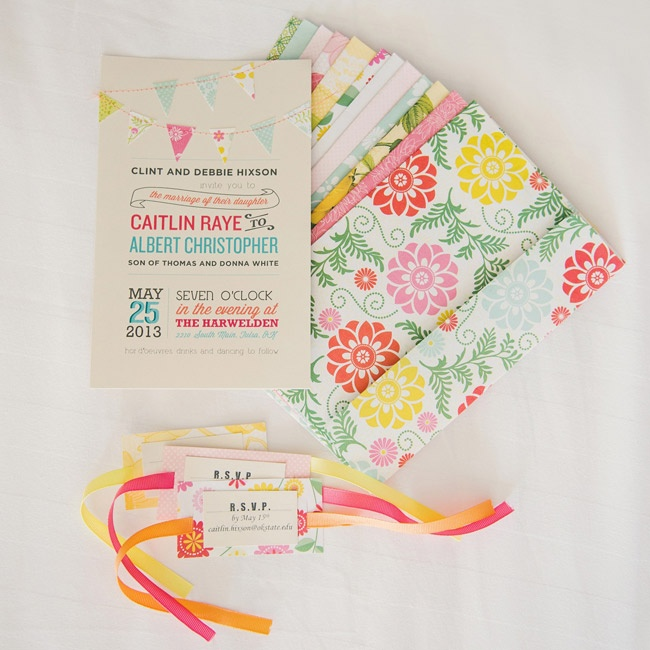 With the help of her mother, Caitlin handmade each of the wedding invitations using bright patterned paper and handmade pennants.