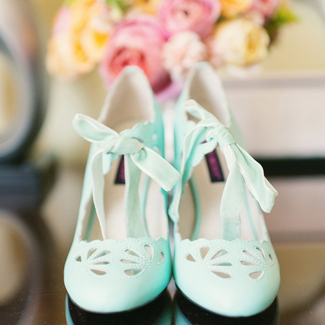 Caitlin walked down the aisle in a pair of Robin's Egg blue heels with cut out details and ribbon.