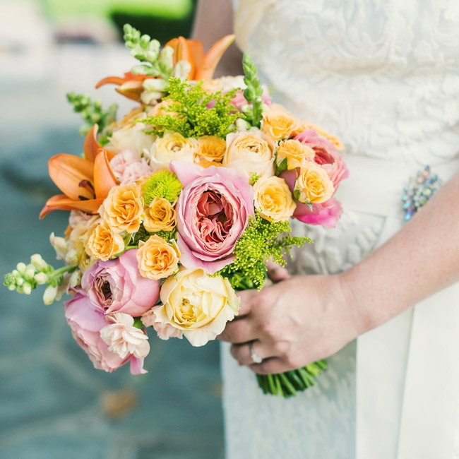 Caitlin carried a bouquet of lilies, stock, roses and peonies in shades of yellow, orange and pink.