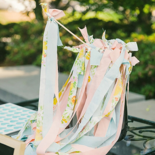 Caitlin handmade celebratory streamers for each guest to wave as the couple exited the ceremony.