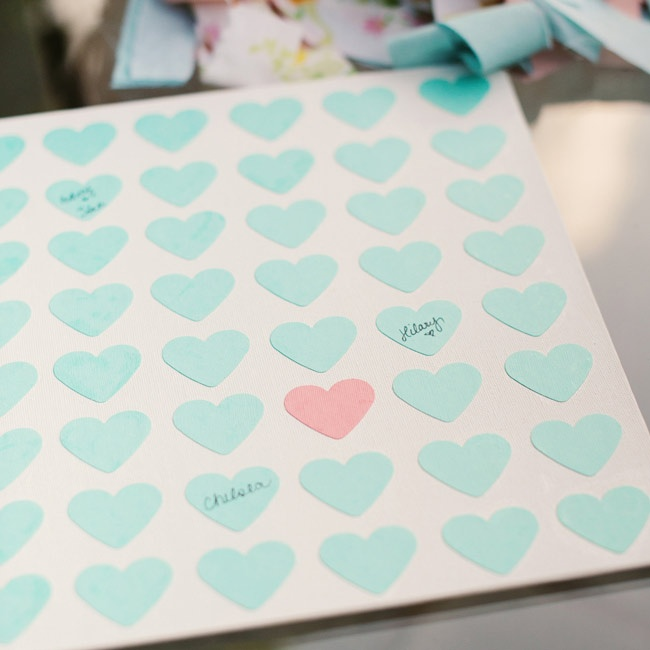 Guests signed their names in little teal and pink hearts on the pages of the guestbook.