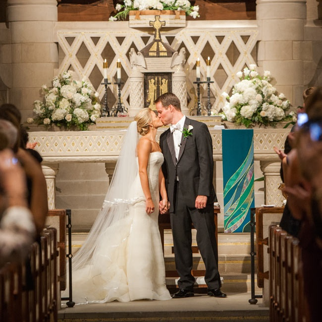 Danielle and Sean exchanged vows at St. Hugo of the Hills – Stone Chapel, where the bride was baptized and confirmed, with ivory hydrangea and rose arrangements decorating the traditional chapel.