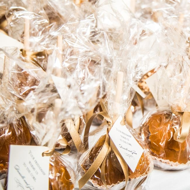 "Guests were treated to caramel apples from Yates Cider Mill in Rochester, Michigan with a decorative tag that said ""Your friendship warms us to the core.""  ""I wanted something in addition to the welcome baskets that embodied Michigan in the fall,"" Danielle says. ""I couldn't think of anything better than caramel apples and everyone took a piece of M ..."