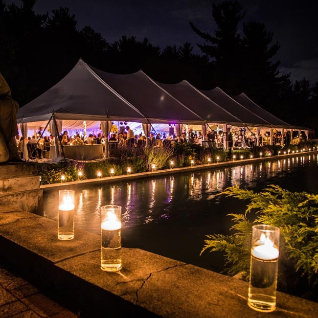 Lush gardens and a lit reflection pond surrounded the formal tented reception.