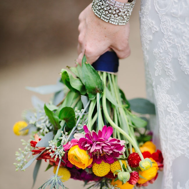 The bridal bouquet was a colorful collection of late summer flowers that were gently arranged and tied with burlap and navy grosgrain ribbon.