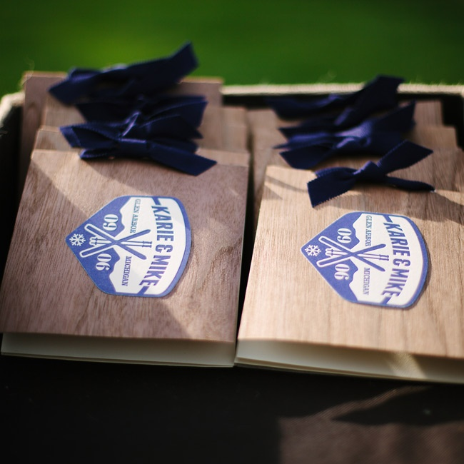 "The creative ""wooden"" programs were folded wood veneer booklets with a letterpressed logo and a navy grosgrain ribbon."