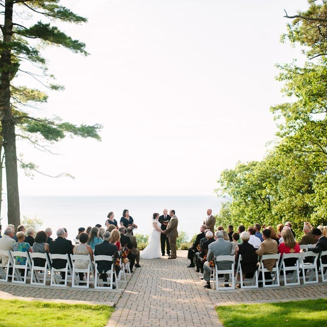 The ceremony took place atop Bay Mountain overlooking Lake Michigan and the couple left this stunning view as the main decor.