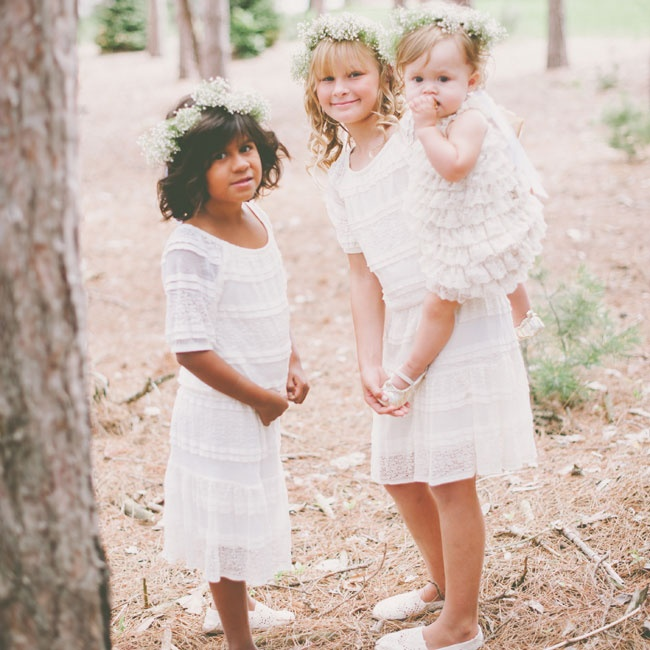 The flower girls wore lace and linen dresses that had a bohemian look and accessorized with flower crowns made from baby's breath.
