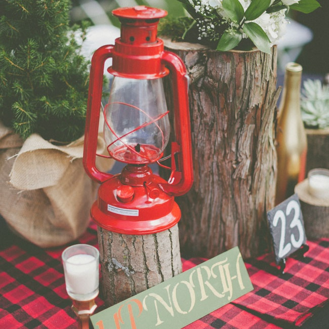 "Each table was marked with a small slate square table number and a unique woodland inspired name like ""Up North."""