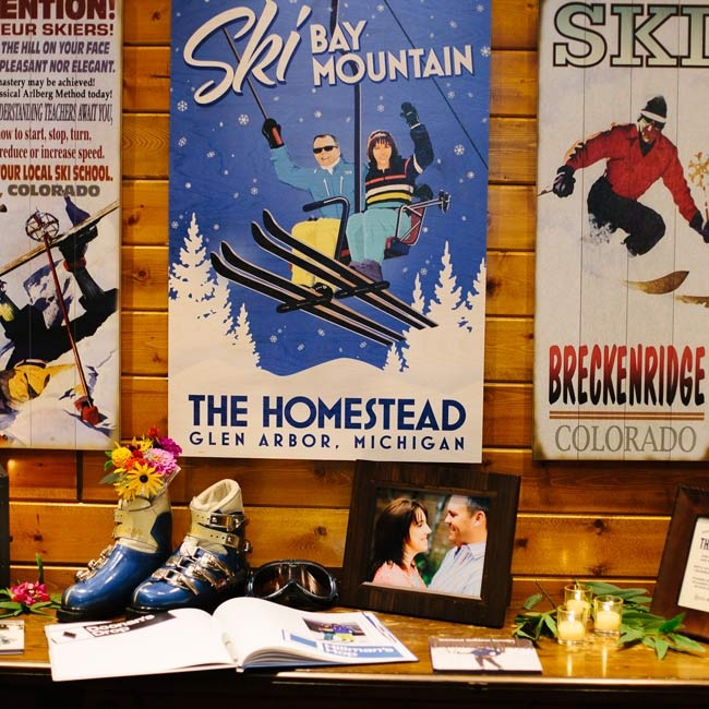 A variety of ski-related signs decorated the reception's entrance table including an illustration of the newlyweds printed on wood.