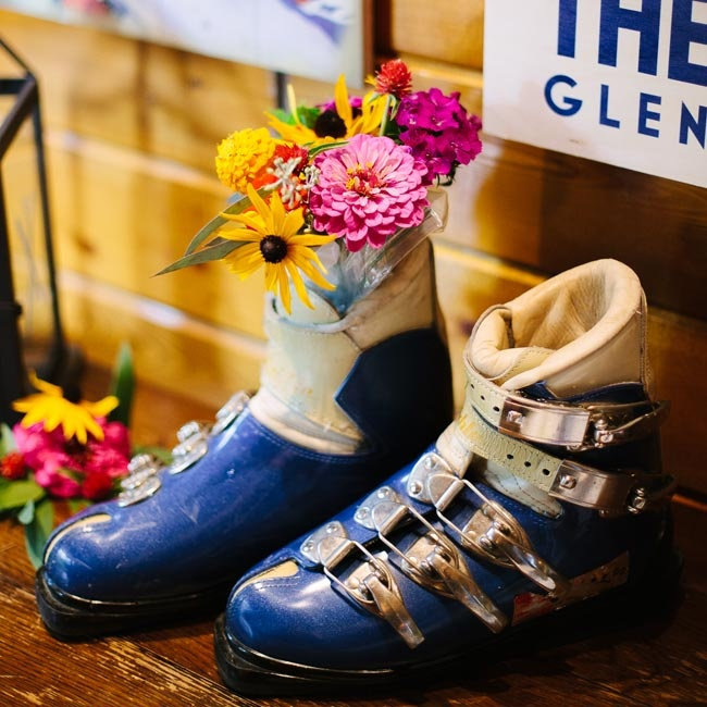 To go along with the vintage ski theme, retro ski boots were filled with vibrant flower arrangements.