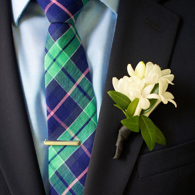 The groomsmen all wore navy J.Crew suits and accessorized with colorful plaid ties and white boutonnieres.