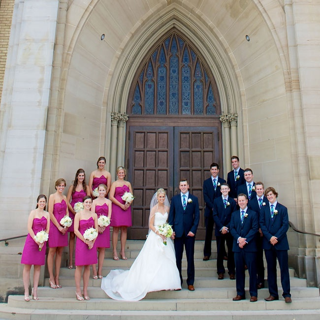 """Kelly selected a short fuchsia dress from J.Crew for her seven bridesmaids.""""I wanted them to be comfortable in what they had on, but also have it be something fun that they could wear to another wedding or event,"""" Kelly explains."""
