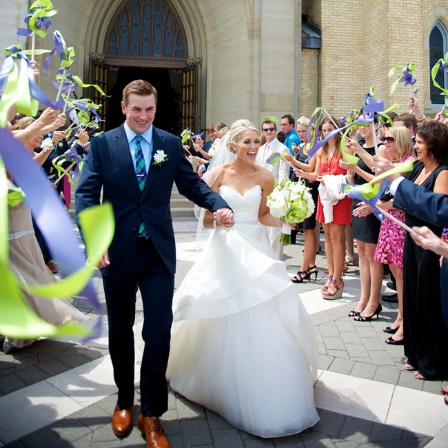 Guests surrounded Kelly and Ryan with celebratory ribbon wands during their cheerful recessional.