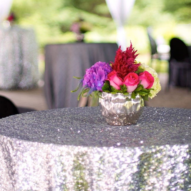 Kelly and Ryan added drama to their outdoor cocktail hour with silver sparkle table cloths. There was an outdoor cocktail portion where we had silver sparkle tablecloths.